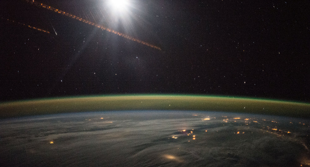 ESA (European Space Station) astronaut Samantha Cristoforetti on board the International Space Station Dec. 13th, 2014 took this night exposure of the Earth showing an Aurora with city lights over the Baltic countries of northern Europe and England.