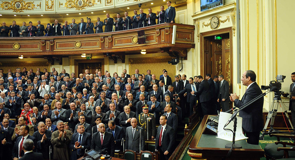 In this photo provided by Egypt's state news agency MENA, Egyptian President Abdel-Fattah el-Sissi, addresses parliament in Cairo, Egypt, Saturday, Feb. 13, 2016