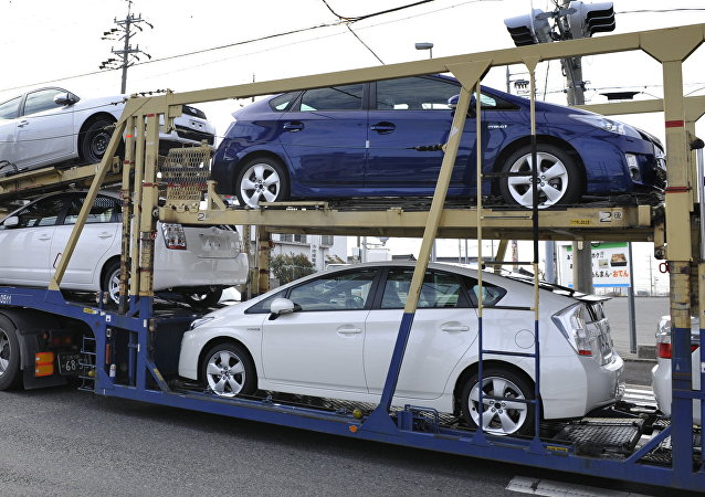 A carrier transports Toyota vehicles including the new Prius hybrid vehicles near the Toyota Motor Corp. Tsutsumi Plant in the town of Toyota, Japan's Aichi Prefecture