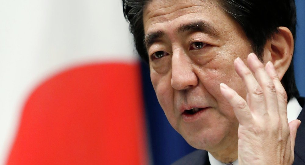 Japan's Prime Minister Shinzo Abe attends a news conference at his official residence in Tokyo November 21, 2014
