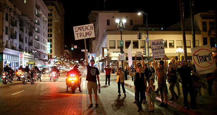 Demonstrators walk through Downtown San Diego in protest to the election of Republican Donald Trump as the president of the United States in San Diego, California, U.S. November 9, 2016