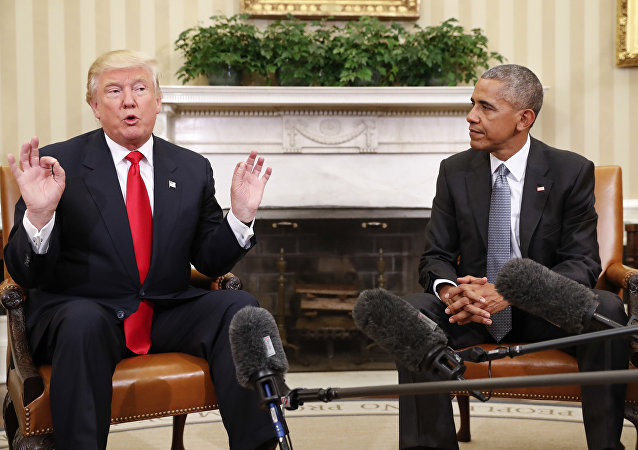 President Barack Obama listens to President-elect Donald Trump speak to members of the media during their meeting in the Oval Office of the White House in Washington, Thursday, Nov. 10, 2016