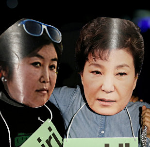 Protesters wearing cut-outs of South Korean President Park Geun-hye (R) and Choi Soon-sil attend a protest denouncing Park over a recent influence-peddling scandal in central Seoul, South Korea, October 27, 2016.