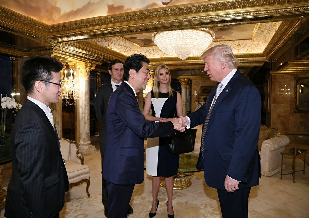 Japan's Prime Minister Shinzo Abe meets with U.S. President-elect Donald Trump (R) at Trump Tower in Manhattan, New York, U.S., November 17, 2016