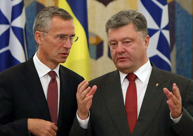 NATO Secretary General Jens Stoltenberg, left, and Ukrainian President Petro Poroshenko talk before the meeting with he media in Kiev, Ukraine, Tuesday, Sept. 22, 2015