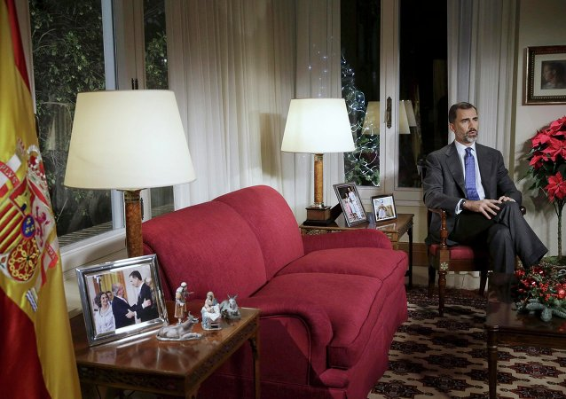 Spain's King Felipe VI delivers a Christmas Eve address at Zarzuela palace in Madrid December 24, 2014.