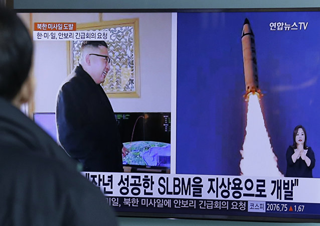 A man watches a TV news program showing photos published in North Korea's Rodong Sinmun newspaper of North Korea's Pukguksong-2 missile launch and North Korean leader Kim Jong Un at Seoul Railway Station in Seoul, South Korea, Monday, Feb. 13, 2017