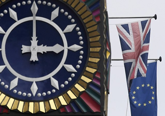 The British Union flag and the European Union flag are seen flying behind a clock in the City of London, Britain, January 16 , 2017.
