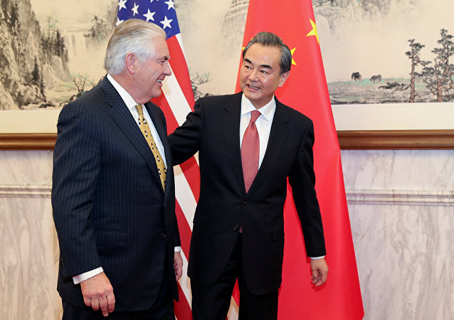 Chinese Foreign Minister Wang Yi (R) talks with U.S. Secretary of State Rex Tillerson at Diaoyutai State Guesthouse on March 18, 2017 in Beijing, China