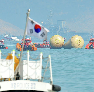 South Korean rescue teams take part in recovery operations at the site of the sunken 'Sewol' ferry, marked with buoys, off the coast of the South Korean island of Jindo