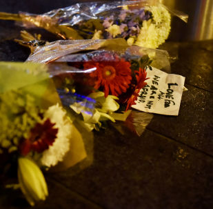 Flowers are laid at the scene after an attack on Westminster Bridge in London, Britain, March 22, 2017.