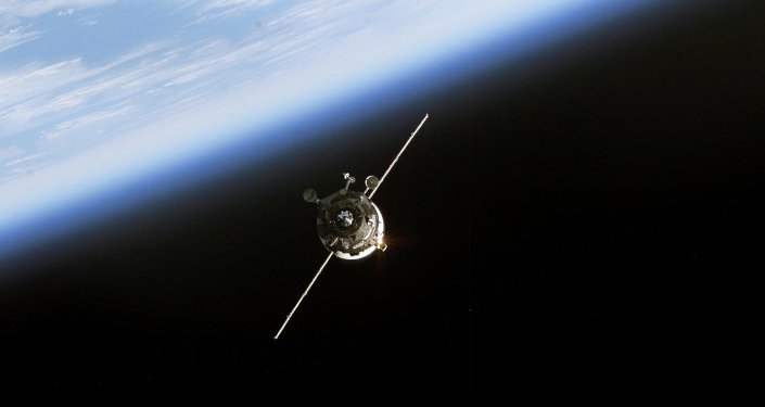 In this 11 June, 2003 NASA image an unmanned Progress supply vehicle (L), backdropped by the blackness of space and Earth's horizon, approaches the Pirs Docking Compartment (out of frame) attached to the Zvezda Service Module on the International Space Station (ISS)